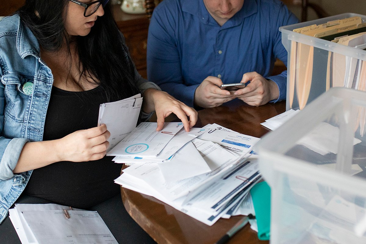 A couple organize tax-related paperwork.